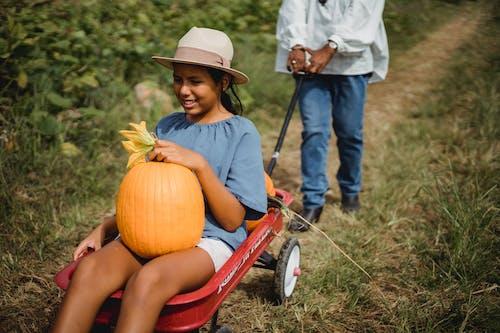 Cute teen girl riding in cart