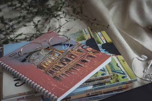 Set of notepads and eyeglasses