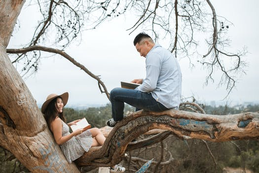 couple reading books outside