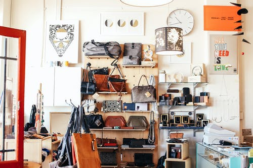 Assorted purses on shelves in shop