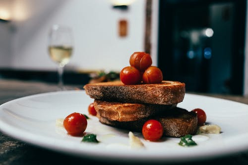 Bread With Tomato on White Ceramic Plate