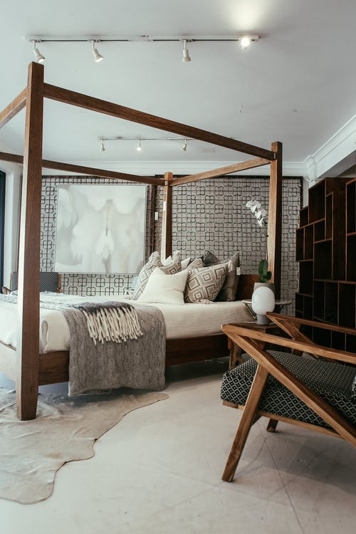 Brown Wooden Bed Frame With White Bed Linen