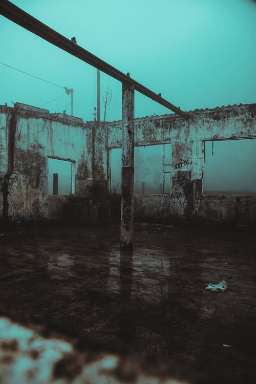 Shabby abandoned building in foggy weather