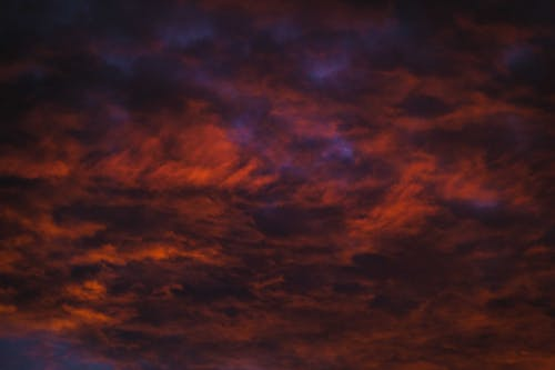Heavy red highlighted clouds at sunset