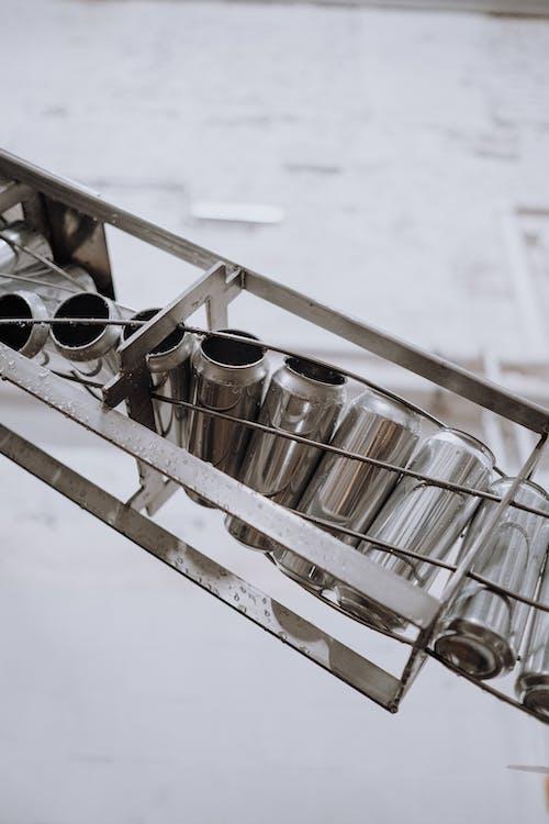 White and Black Ceramic Mugs on Stainless Steel Rack