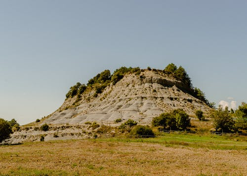 Hill Under Blue Sky