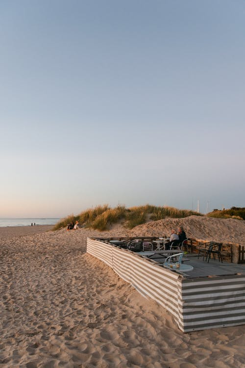 White Wooden Bench on Beach