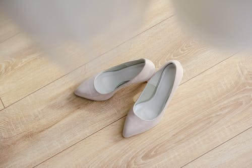 White shoes of bride on parquet