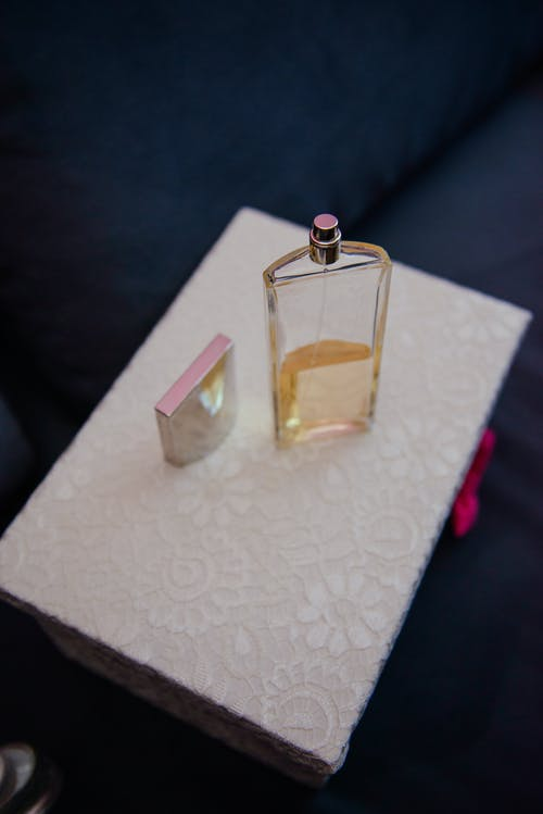 Bottle of perfume on box in room