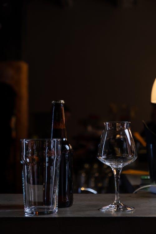 Clear Wine Glass Beside Bottle