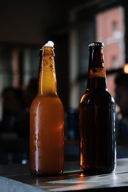 Brown Glass Bottle on Table