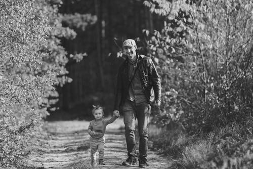 Happy little girl walking with dad