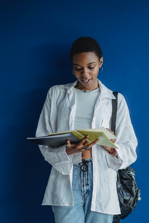 African American female student studying with notepad