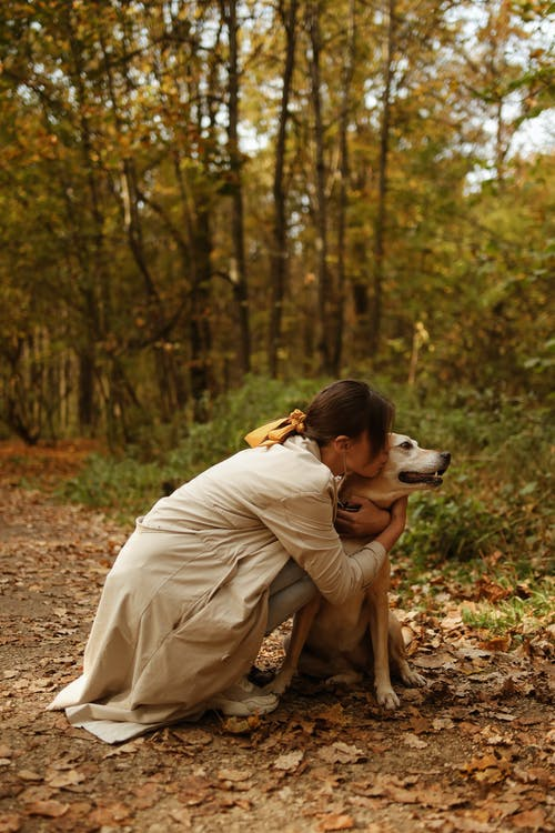 A Woman Kissing Her Dog