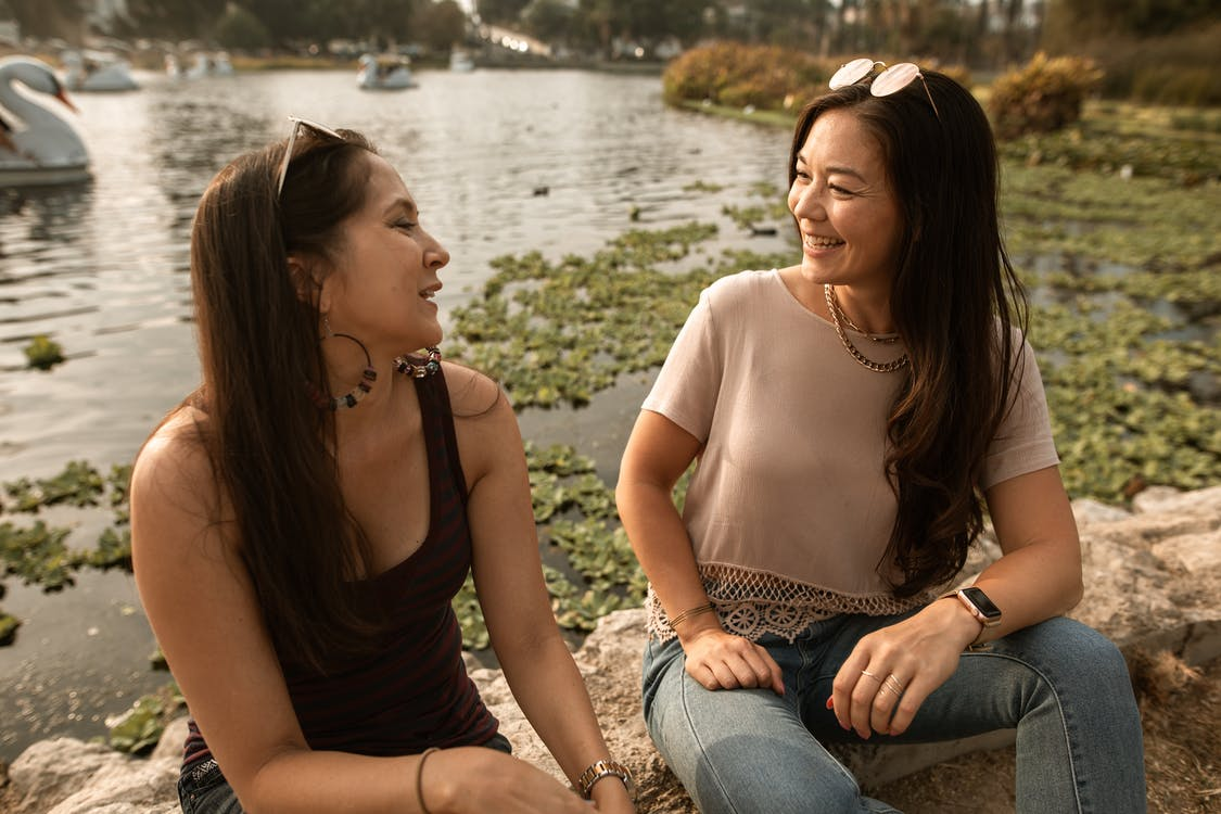 Two Women Talking and Smiling