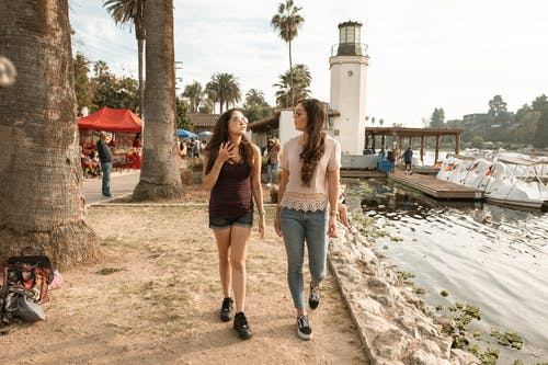 Women Walking and Talking Near a Lake