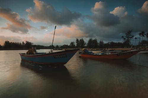 Motorboats on calm river at evening