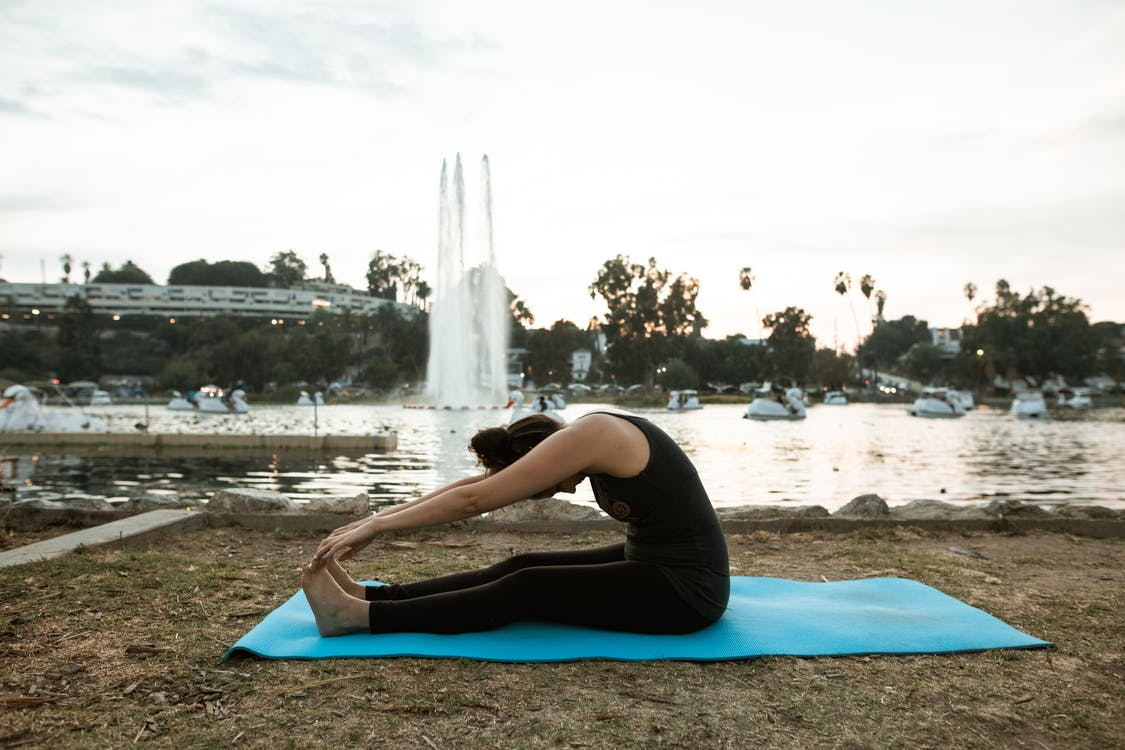 Woman Doing Yoga at a Park
