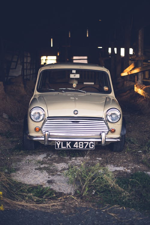Retro car parked in wooden barn