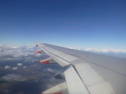 bulut, gökyüzü, kanat, mavi içeren Ücretsiz stok fotoğraf