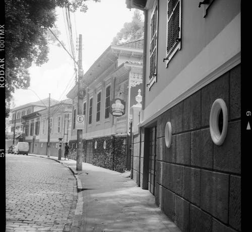 Black and white of ornamental Russian architecture buildings alongside empty pavement in old city