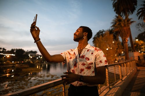 Man Taking a Selfie at a Park