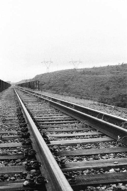 Grayscale Photo of Train Railway