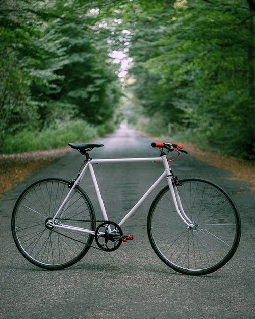 Gray and Red Road Bike on Road