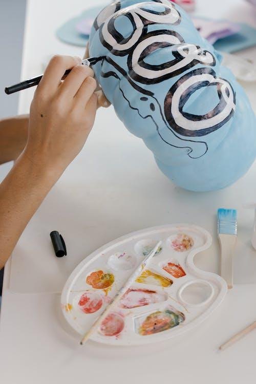 Person Holding Blue Ceramic Mug