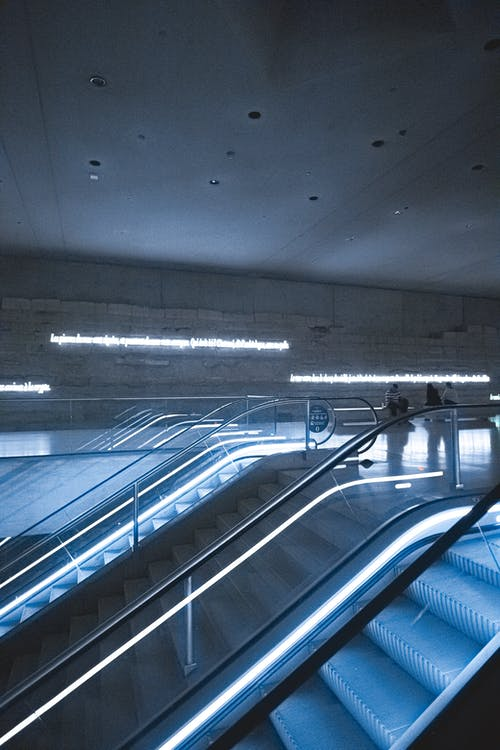 Interior design of  staircase and escalators with lighting under concrete ceiling in subway
