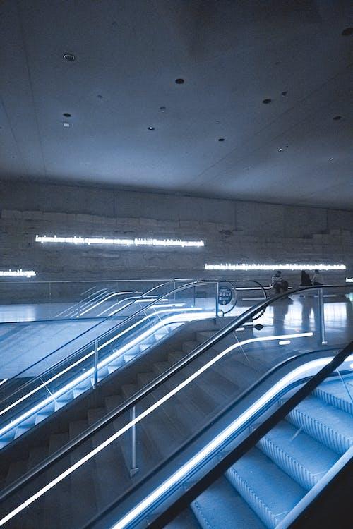 Underground passage with illuminated moving stairs
