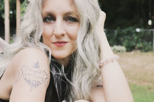 Free stock photo of 50 years old, arm tattoo, blonde