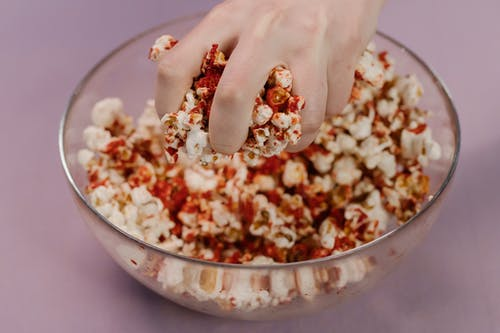 Brown and White Popcorn on Clear Glass Bowl