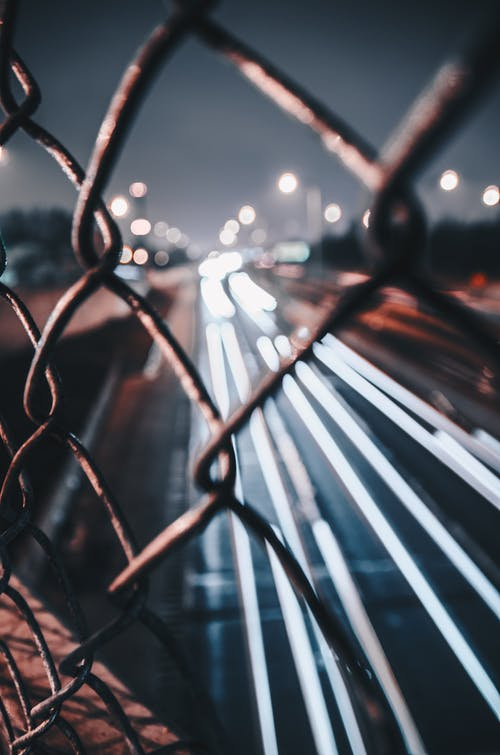 Free stock photo of big city, bokeh, car lights, chain fence