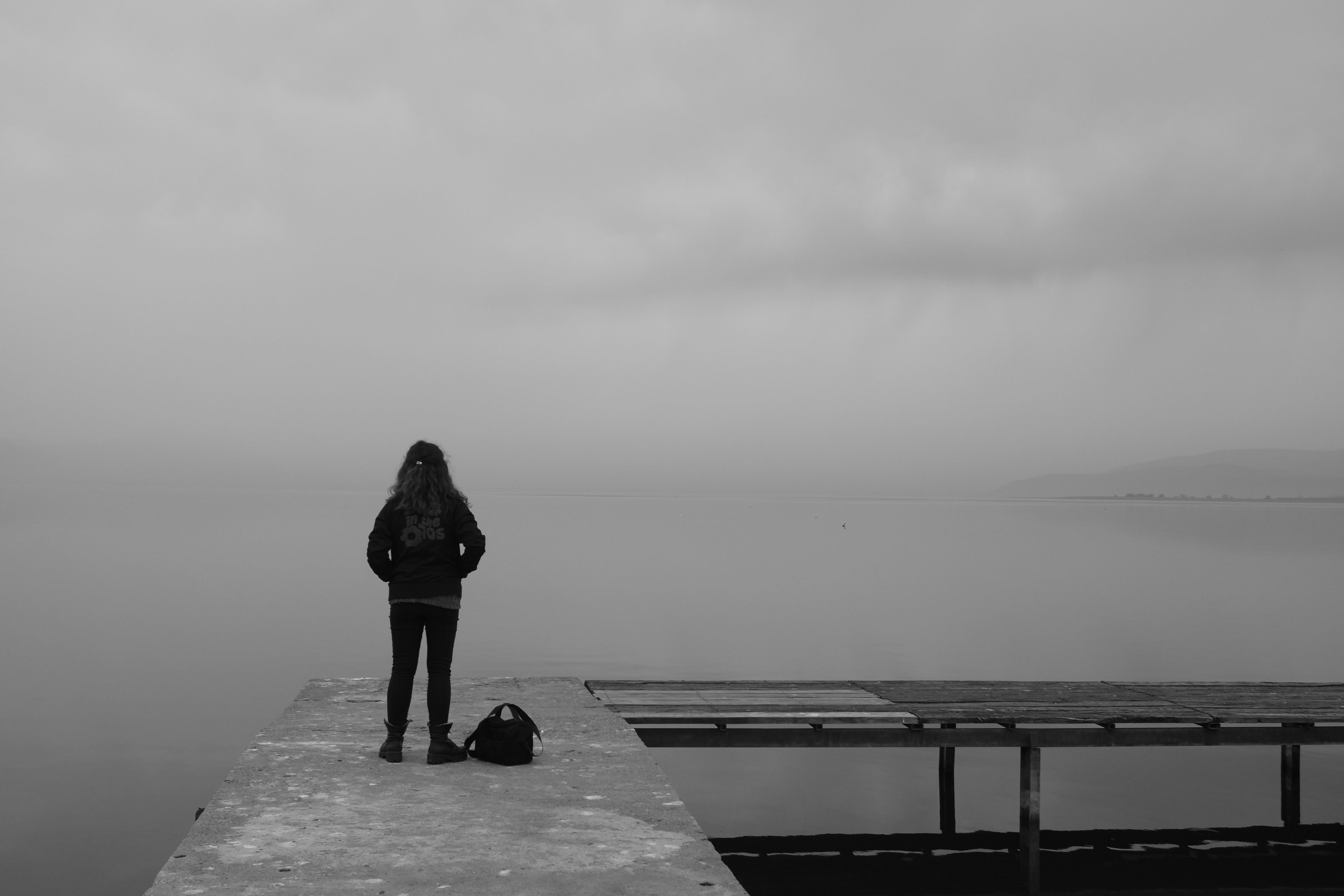 Free stock photo of jetty, sea, black-and-white, person