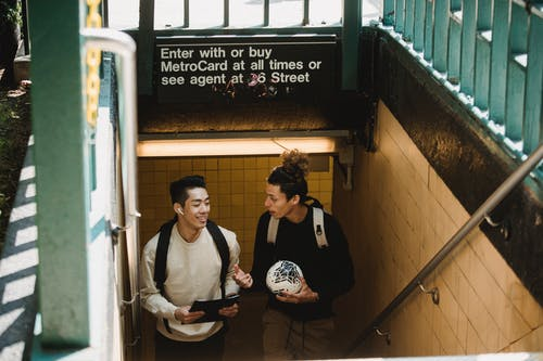 Two Young Men At A Subway Station