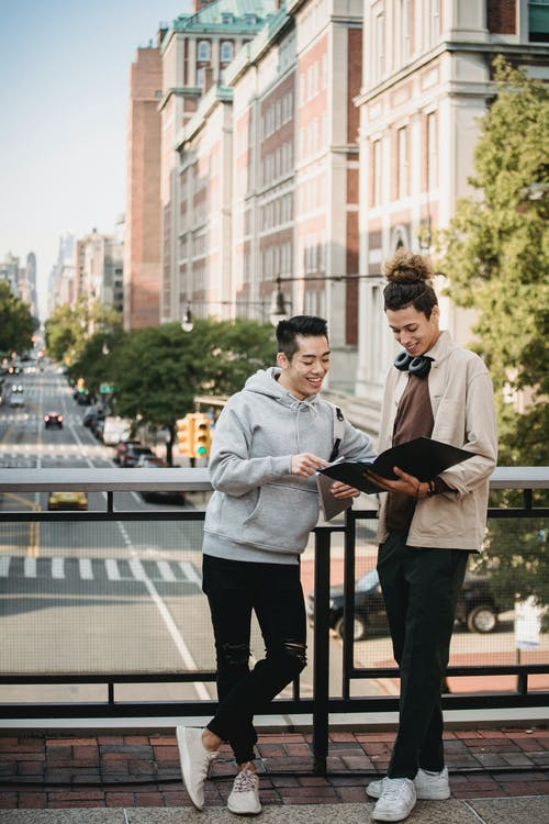 Multiethnic men with tablet and folder