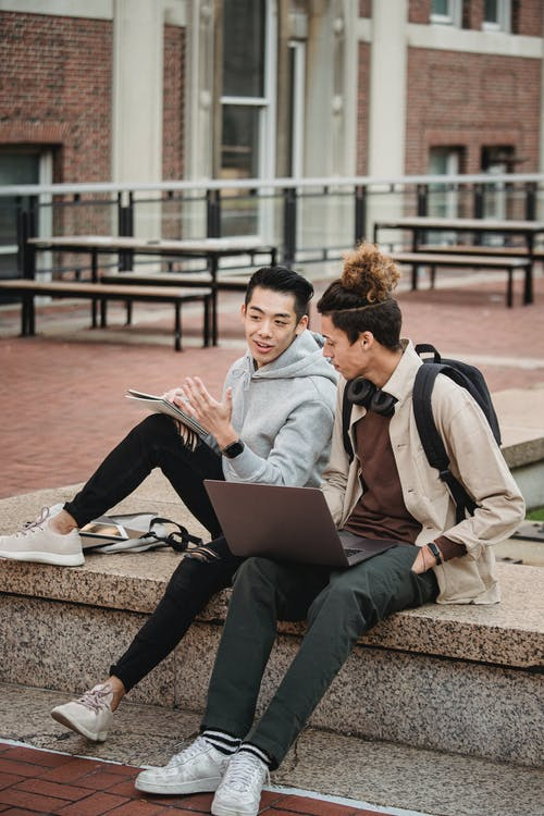 Diverse students with laptop on border