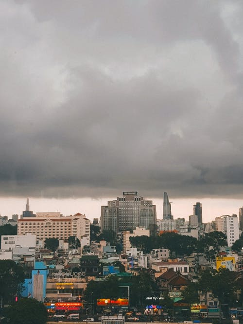 City Skyline Under Gray Cloudy Sky