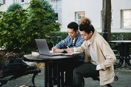 Diligent multiethnic students doing homework together