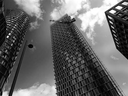 Grayscale and Worms Eye View of High-rise Buildings