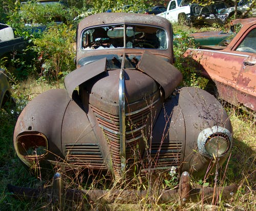 Free stock photo of antique car, Bonnie & Clyde. 1934 Ford, dump, junk yard