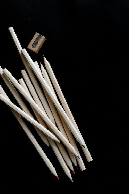 White Sticks on Black Background