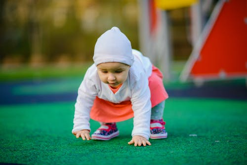 Cute little girl playing on playground