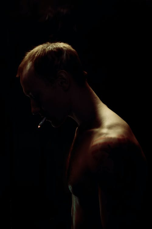 Topless Man With Black Background