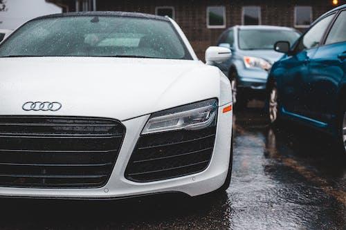 Luxury sports automobile on wet road in rain