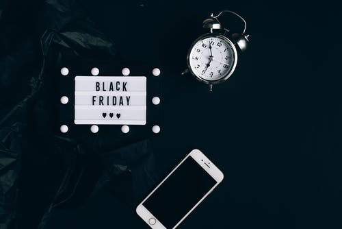 Black Friday Sign, Clock and Smartphone