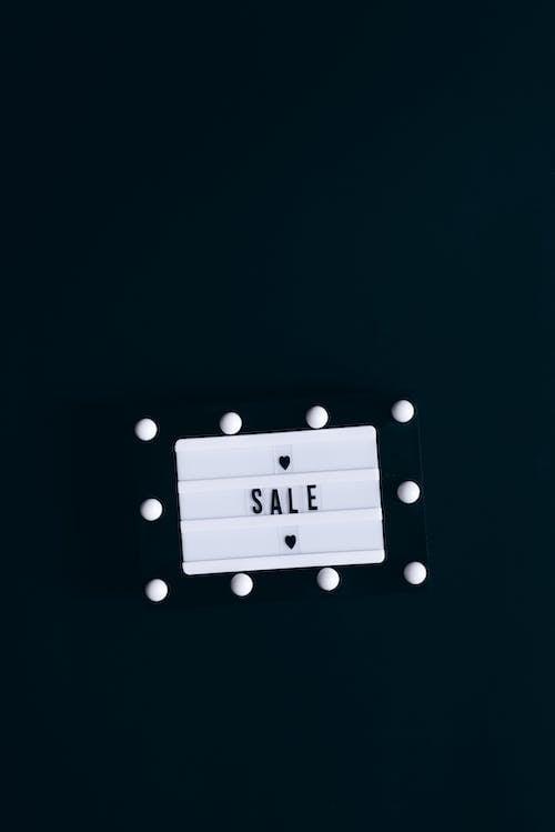 Sale Sign on Black Background