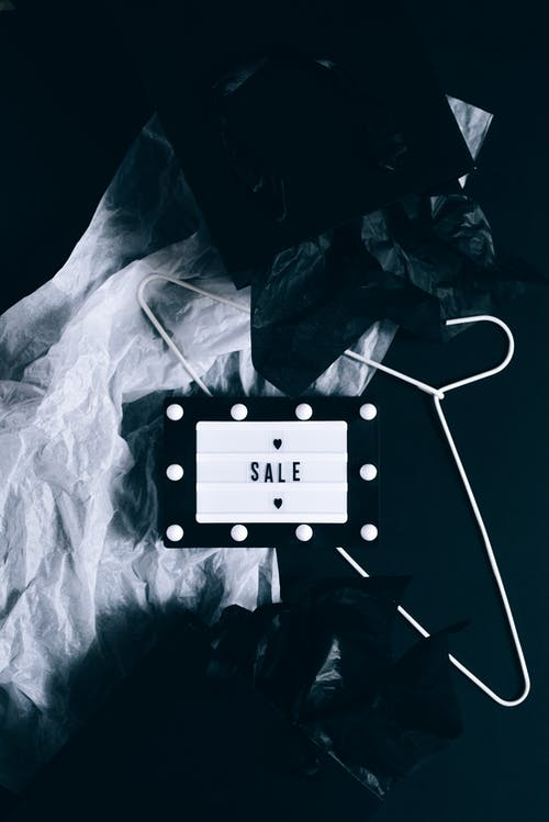 Sale Sign and Black Shopping Bags