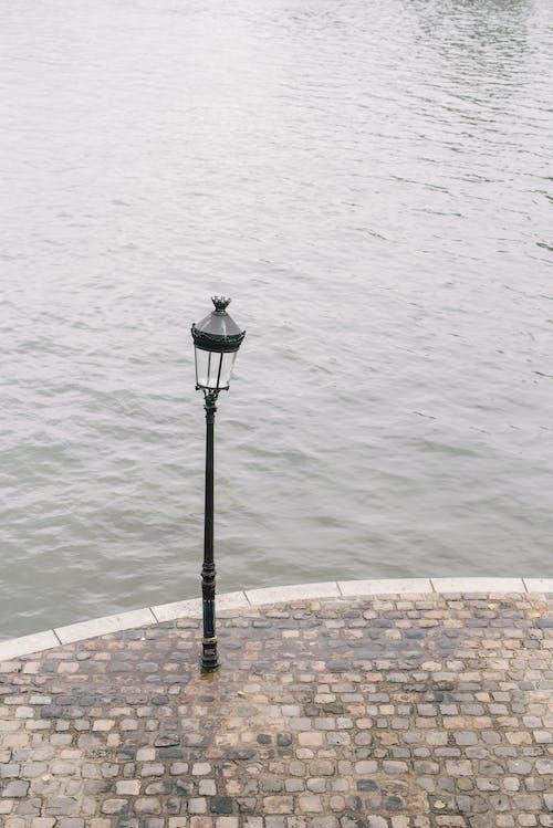 Black Street Lamp on Brown Brick Floor